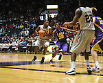 "Ole Miss' Nick Williams (20) vs. LSU's John Isaac (32) at the C.M. ""Tad"" Smith Coliseum in Oxford, Miss. on Saturday, February 25, 2012. (AP Photo/Oxford Eagle, Bruce Newman).."