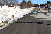 Asphalt road patched with stone screening