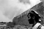 azam warsak, south waziristan, pakistan 2004: a hourse is set alight.  its owner was suspected of providing shelter to al qaeda fighters coming across the border from afghanistan.<br />