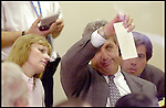 Palm Beach County started the tidious manual recount of the now famous butterfly ballots. Election Supervisor Theresa LePore (who designed the ballots) and County Criminal Court Judge Charles Burton  inspecting the ballots who were rejected by the counting machines.<br />