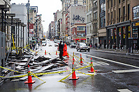 A NYPD officer guards a collapsed scaffold on Broadway in Lower Manhattan after Hurricane Sandy, seen on Tuesday, October 30, 2012. Hurricane Sandy roared into New York disrupting the transit system and causing widespread power outages. Con Edison is estimating it will take four days to get electricity back to Lower Manhattan. (© Frances M. Roberts)