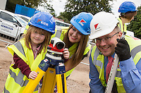 Keeping an eye on things - Sophie Diacopoulos (5) and Abbey Primary School Deputy Head Charlotte Place take a look at their new £4M school site along with Contractor Kier's Site Manager Dave Sessions.
