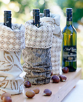 Hand-sewn fabric bags dress each bottle of wine for a celebration
