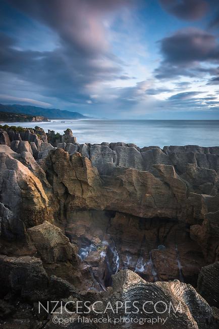 Blowhole at Pancake Rocks, limestone formations in Punakaiki at twilight, Paparoa National Park, West Coast, New Zealand