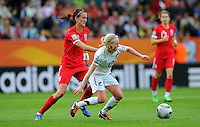 Betsy Hassett (r) of team New Zealand and Jill Scoot of team England during the FIFA Women's World Cup at the FIFA Stadium in Dresden, Germany on July 1st, 2011.