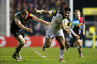 Amanaki Mafi of Bath Rugby gets past George Merrick of Harlequins. Aviva Premiership match, between Harlequins and Bath Rugby on March 11, 2016 at the Twickenham Stoop in London, England. Photo by: Patrick Khachfe / Onside Images