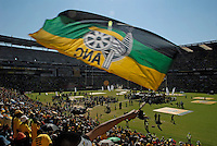 People wave ANC flags at an African National Congress (ANC) election rally held at the Ellis Park Stadium in Johannesburg..