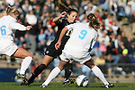 27 November 2009: Wake Forest's Allie Sadow (11) is defended by North Carolina's Whitney Engen (9) and Rachel Givan (left). The University of North Carolina Tar Heels defeated the Wake Forest University Demon Deacons 5-2 at Fetzer Field in Chapel Hill, North Carolina in an NCAA Division I Women's Soccer Tournament Quarterfinal game.