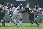 Ole Miss' Evan Swindall (56)  and Ole Miss' Patrick Junen (77) block in Nashville, Tenn. on Saturday, September 17, 2011. Vanderbilt won 30-7..
