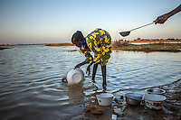 A woman washes pots and pans in the Niger River in the town of Gao. /Felix Features