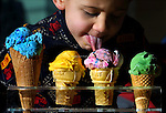 A lucky kid gets to sample a bunch of ice cream flavors at a new store opening.