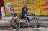 A rickshaw driver in Thamel that is within the greater Kathmandu, Nepal region.