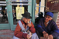 Campesino peasants taking ice cream break in Potosi, Bolivia