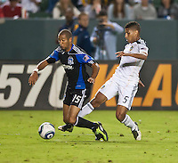 CARSON, CA – August 20, 2011: San Jose Earthquake defender Justin Morrow (15) and LA Galaxy midfielder Sean Franklin (5) during the match between LA Galaxy and San Jose Earthquakes at the Home Depot Center in Carson, California. Final score LA Galaxy 2, San Jose Earthquakes 0.