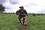SLA SOLDIERS &amp; ELEMENTS OF THE CDF DEFEND THE BERI CROSSING IN A HEAVY FIREFIGHT WITH THE RUF AFTER TAKING THE AREA THIS MORNING FROM REBEL HANDS...<br /> <br /> 21 May 2000 Sierra Leone