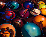 Colorful hand-painted wooden bowls displayed at a crafts fair in Vermont