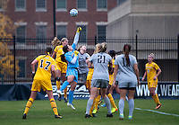 Jessica Wiggins (1) of La Salle punches the ball away from Marina Paul (5) of Georgetown during the first round of the NCAA tournament at Shaw Field in Washington, DC.  Georgetown defeated La Salle, 2-0.