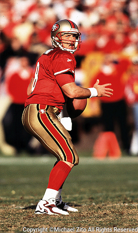 San Francisco 49ers QB Steve Young looks to the endzone for an open receiver.