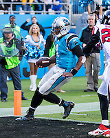 The Carolina Panthers defeated the Atlanta Falcons 34-10 in an inter-division rivalry played in Charlotte, NC at Bank of America Stadium.  Carolina Panthers quarterback Cam Newton (1) runs for a touchdown.