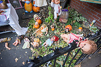 A gruesome Halloween display is seen in the neighborhood of Boerum Hill in Brooklyn in New York on Wednesday, October 23, 2013. The holiday extravaganza  in the front yard of Brooklynite Joyce Draganosky features mutilated dolls with blood galore and is elicting both pro and con reactions from residents and passer by.   (© Richard B. Levine)