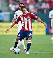 CARSON, CA – July 2, 2011: Chivas USA defender Zarek Valentin (20) during the match between Chivas USA and Chicago Fire at the Home Depot Center in Carson, California. Final score Chivas USA 1, Chicago Fire 1.