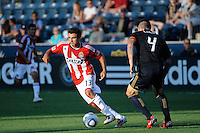 Jonathan Bornstein (13) of CD Chivas USA is marked by Danny Califf (4) of the Philadelphia Union. The Philadelphia Union defeated CD Chivas USA 3-0 during a Major League Soccer (MLS) match at PPL Park in Chester, PA, on September 25, 2010.
