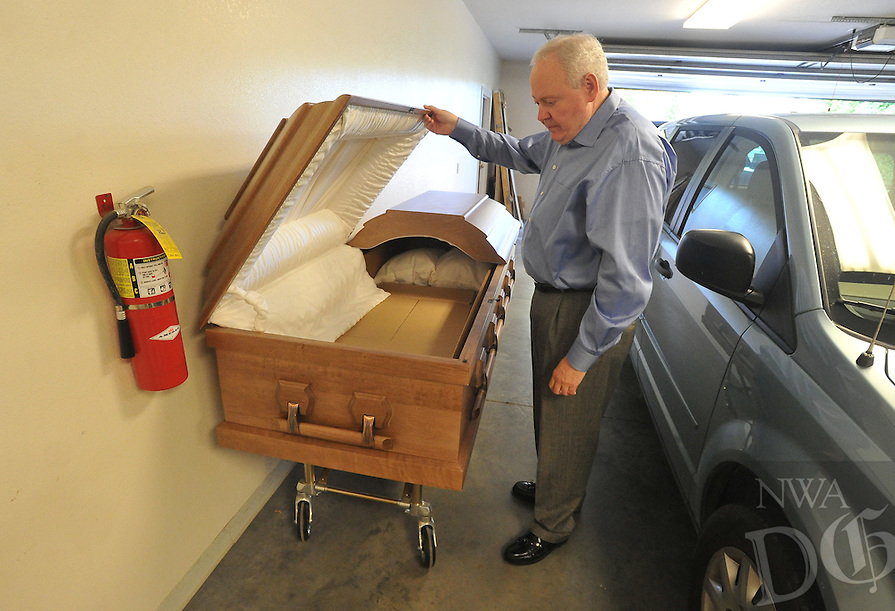 NWA Democrat-Gazette/MICHAEL WOODS &bull; @NWAMICHAELW<br /> Tommy Holland, with Beard's Funeral Chapel in Fayetteville, shows a rental casket at the Fayetteville Funeral Chapel Tuesday November 3, 2015.
