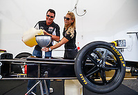 Aug 19, 2016; Brainerd, MN, USA; Papa Johns pizza founder John Schnatter (left) pours nitro fuel into the gas tank for the dragster of NHRA top fuel driver Leah Pritchett in the pits during qualifying for the Lucas Oil Nationals at Brainerd International Raceway. Mandatory Credit: Mark J. Rebilas-USA TODAY Sports