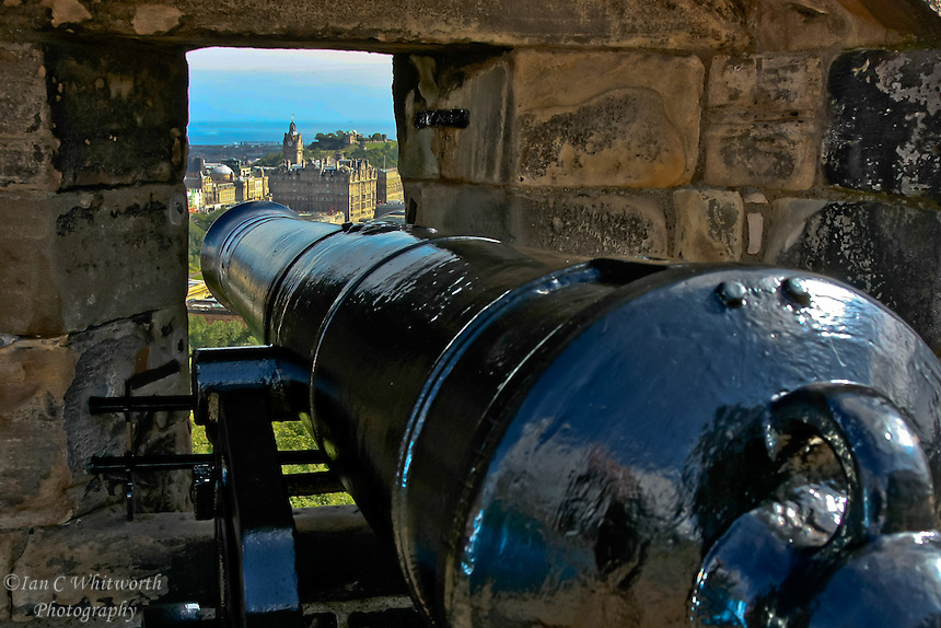 Looking out over Edinburgh from a cannon at the castle