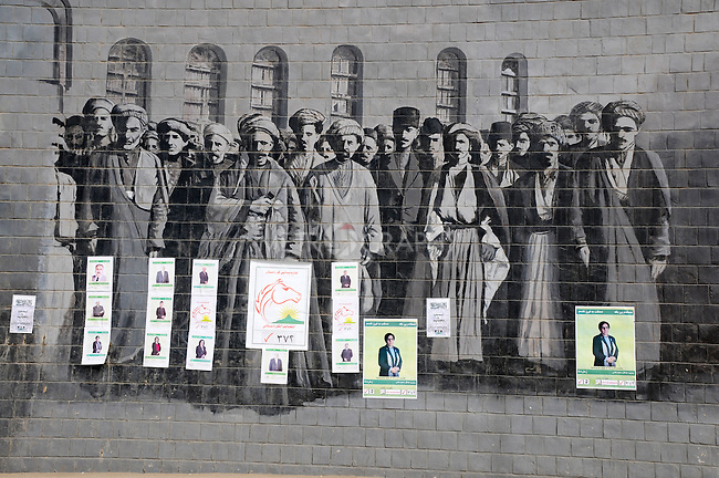 SULAIMANIYAH, IRAQ:  Election posters appear on a wall murual on the first day of official election campaigning...Election workers start their campaigns for the Iraqi Parliamentary Elections due to be held March 7th, 2010...Photo by Pazhar Muhammed/Metrography