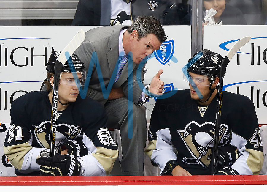 Head coach Mike Sullivan of the Pittsburgh Penguins talks with Daniel Sprong #41 of the Pittsburgh Penguins on the bench in his first game against the Washington Capitals during the game at Consol Energy Center in Pittsburgh, Pennsylvania on December 14, 2015. (Photo by Jared Wickerham / DKPS)