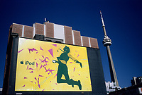 an I Pod giant billboard ad on King and Spadina street<br />  the CN Tower is in the background.<br /> <br /> The CN Tower, located in Toronto, Ontario, Canada, is the world's tallest freestanding structure on land, standing 553.33 meters (1,815 ft 5 in) tall. It is considered the signature icon of the city, attracting more than two million international visitors annually<br /> <br /> Photo : Pierre Roussel - Images Distribution