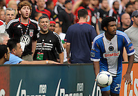 WASHINGTON, D.C. - AUGUST 19, 2012:  Fans of DC United yell at Sheanon Williams (25) of the Philadelphia Union during an MLS match at RFK Stadium, in Washington DC, on August 19. The game ended in a 1-1 tie.