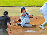 2 July 2011: Tri-City ValleyCats infielder John Hinson slides home safely during game action against the Vermont Lake Monsters at Centennial Field in Burlington, Vermont. The Lake Monsters rallied from a 4-2 deficit to defeat the ValletCats 7-4 in NY Penn League action. Mandatory Credit: Ed Wolfstein Photo