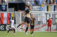 Pat Phelan (28) of the New England Revolution and Andrew Jacobson (8) of the Philadelphia Union go up for a header. The Philadelphia Union and the New England Revolution  played to a 1-1 tie during a Major League Soccer (MLS) match at PPL Park in Chester, PA, on July 31, 2010.