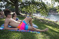 """Known for topless sunbathing and a good summer fun place to beat the brutal Texas summer heat, Barton Springs Pool is one of a kind and know as """"America's Best Swimming Pool."""""""