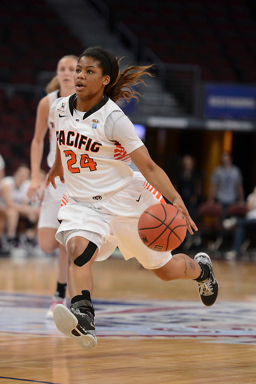 March 7, 2014; Las Vegas, NV, USA; Pacific Tigers guard KiKi Moore (24) dribbles against the Portland Pilots during the first half of the WCC Basketball Championships at Orleans Arena.