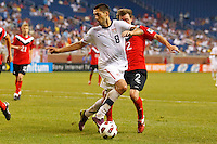 7 June 2011: USA Men's National Team forward Clint Dempsey (8) dribbles the ball as Canada midfielder Nikolas Ledgerwood (2) defends during the CONCACAF soccer match between USA MNT and Canada MNT at Ford Field Detroit, Michigan. USA won 2-0.