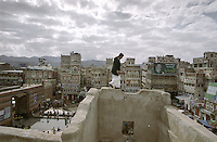 View above the square of Bab al-Yemen in the Old City of Sana'a. The gate on the left is one of the entrances to the walled city, one of the most ancient towns in the Arab world which was established on an important trading route over two thousand years ago.