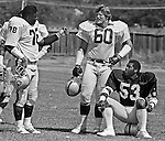 Oakland Raiders training camp August 10, 1982 at El Rancho Tropicana, Santa Rosa, California.   Oakland Raiders tackle Art Shell (78) talks with guard Curtis Marsh (60) and linebacker Rod Martin (53).