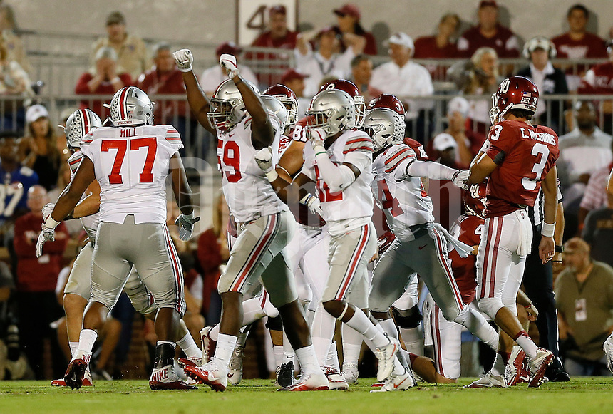 Ohio State Buckeyes defensive lineman Tyquan Lewis (59) celebrates after Oklahoma Sooners place kicker Austin Seibert (43) misses a field goal during the first quarter of the NCAA football game at Memorial Stadium in Norman, Oklahoma on Sept. 17, 2016. (Adam Cairns / The Columbus Dispatch)