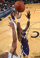 Jan. 2, 2011; Charlottesville, VA, USA; LSU Tigers forward Malcolm White (5) shoots over Virginia Cavaliers forward Akil Mitchell (25) during the game at the John Paul Jones Arena. Virginia won 64-50. Mandatory Credit: Andrew Shurtleff