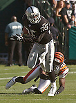 Oakland Raiders running back Charlie Garner (25) on Sunday, September 14, 2003, in Oakland, California. The Raiders defeated the Bengals 23-20.