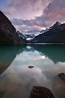 Colorful sunset over Lake Louise with Victoria Glacier shrouded in colorful clouds