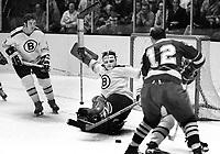 Boston Bruins goalie Ed Johnston blocks shot from the Seals Gary Jarrett...#10 Rick Smith on left. (1970 photo/Ron Riesterer)