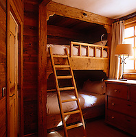 One of the pairs of bunkbeds made from reclaimed wood in the children's bedroom