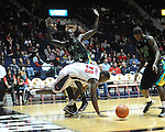 "Ole Miss' Reginald Buckner (23) is fouled by Coastal Carolina's El Hadji Ndieguene (11) at the C.M. ""Tad"" Smith Coliseum in Oxford, Miss. on Tuesday, November 13, 2012."