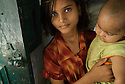 Portrait of a young girl and child in a village near the Taj Mahal in Agra, India
