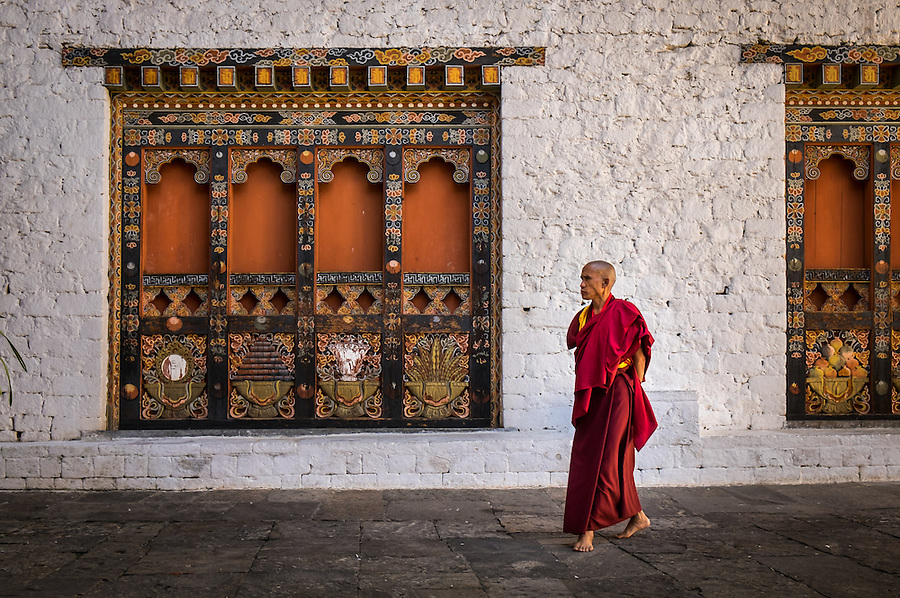 PUNAKHA, BHUTAN - CIRCA October 2014: Monk walking in the Punakha Dzong, a landmark in Punakha, Bhutan