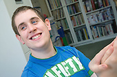 Teenage boy with Autism smiling. MR
